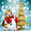 Stock Photo: Snowman with Blue Holiday Background