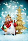 Snowman with Blue Holiday Background — Stock Photo