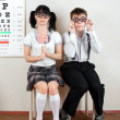Two person wearing spectacles in office at doctor — 图库照片 #7719096