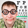 Person wearing spectacles in an office at the doctor — Stock Photo #7719110