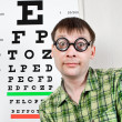 Foto Stock: Person wearing spectacles in an office at the doctor