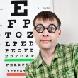 Stockfoto: Person wearing spectacles in an office at the doctor