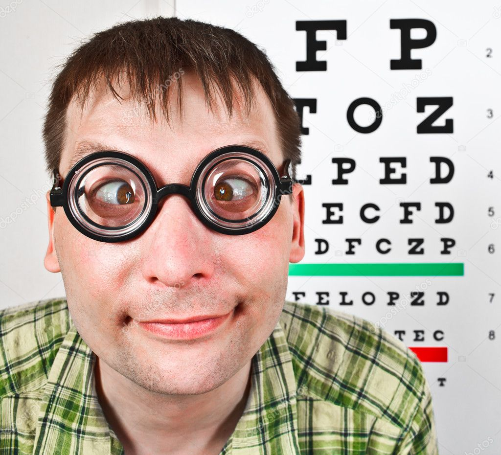Person wearing spectacles in an office at the doctor  Stock Photo #7719110