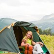 Girl has a rest in green tent — Stock Photo