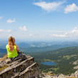 Girl sits on a rock — Stock Photo #6835801