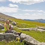 Emale tourist resting at mountain peak — Stock Photo