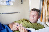 Mature man riding a sleeper train — Stock Photo