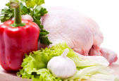 Crude chicken carcass with vegetables — Stock Photo