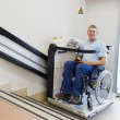 Man in an invalid chair - Stock Photo