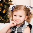 Little girl at a Christmas fir-tree. — Stock Photo #7354574