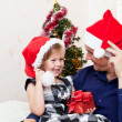 Father with a small daughter in expectation of Christmas — Stock Photo #7354583