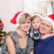 Family with a small daughter in expectation of Christmas — Stock Photo #7354588