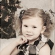Little girl at a Christmas fir-tree — Stock Photo #7354604