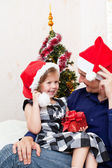 Father with a small daughter in expectation of Christmas — Stock Photo