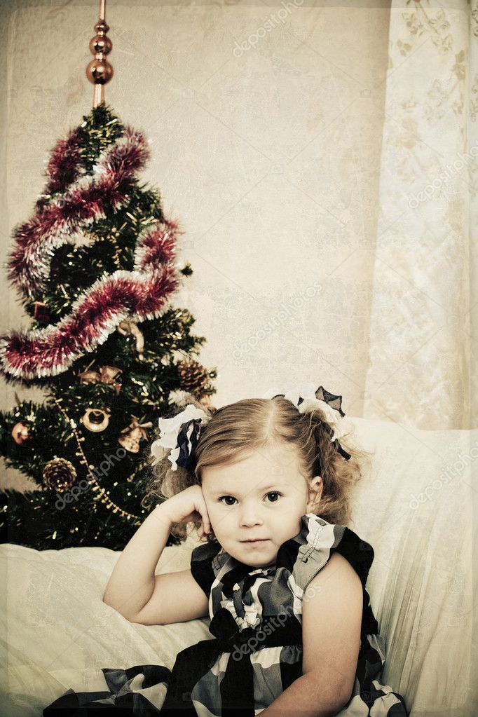 Little girl at a Christmas fir-tree. — Stock Photo #7354570