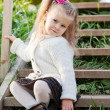 Beautiful little girl on walk in autumn park — Stock Photo #7375800
