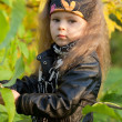 Stock Photo: Beautiful little girl on walk in autumn park