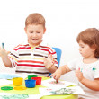 Brother and the sister draw finger-type paints — Stock Photo #7375816