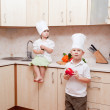 Small children on kitchen help to make a dinner — Stock Photo