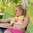 Happy young woman has a rest in a hammock — Stock Photo