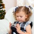 Little girl at a Christmas fir-tree. — Stock Photo #7403543