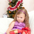Little girl at a Christmas fir-tree. — Stock Photo #7403588