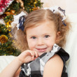 Little girl at a Christmas fir-tree. — 图库照片 #7509175