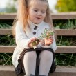 Beautiful little girl on walk in autumn park — Stockfoto