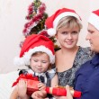 Family with a small daughter in expectation of Christmas — Stock Photo #7509213