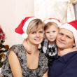 Family with small daughter in expectation of Christmas — Stock Photo #7509222