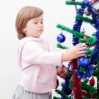 Royalty-Free Stock Photo: Little girl at a Christmas fir-tree.
