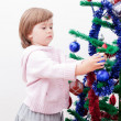 Little girl at a Christmas fir-tree. — Stock Photo #7509277