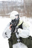 Armed men in a camouflage play a paintball — Stock Photo