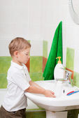 Little boy washes in a bathroom — Stock Photo