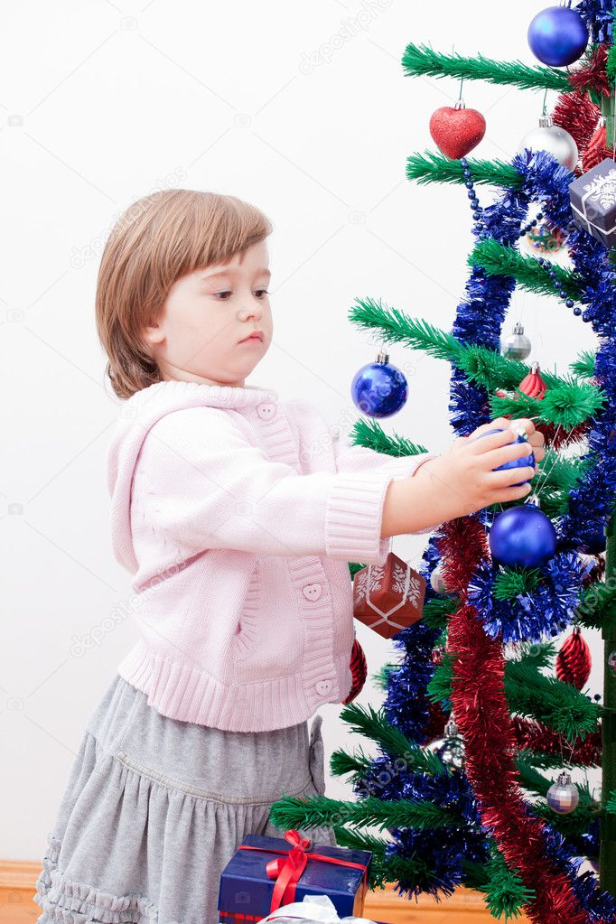 Little girl at a Christmas fir-tree. — Stok fotoğraf #7509277