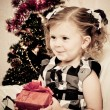 Little girl at a Christmas fir-tree. — Foto Stock