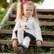 Beautiful little girl on walk in autumn park — Stock Photo #7629469