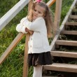 Beautiful little girl on walk in autumn park — Stock Photo #7629471