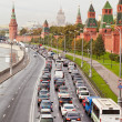 Automobile jam on the Kremlin quay in rush hour. — Stock Photo