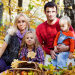 Happy family on walk in autumn park — Stock fotografie