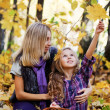 Stockfoto: Happy family on walk in autumn park