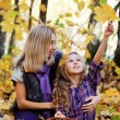 Happy family on walk in autumn park — Stock Photo #7629610