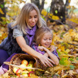 Happy family on walk in autumn park — Stock Photo