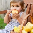 Little girl with appetite is juicy pear — Stok Fotoğraf #7629641
