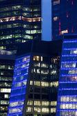 Modern skyscrapers at night. — Stock Photo