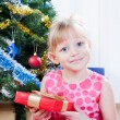 Little girl at a Christmas fir-tree — Stock Photo #7849375