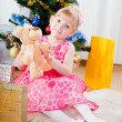 Little girl at a Christmas fir-tree — Stock Photo #7849378