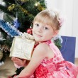 Little girl at a Christmas fir-tree — Stock fotografie #7849381