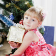 Little girl at a Christmas fir-tree — Stock Photo #7849381