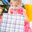 Little girl at a Christmas fir-tree — Stock Photo #7849382